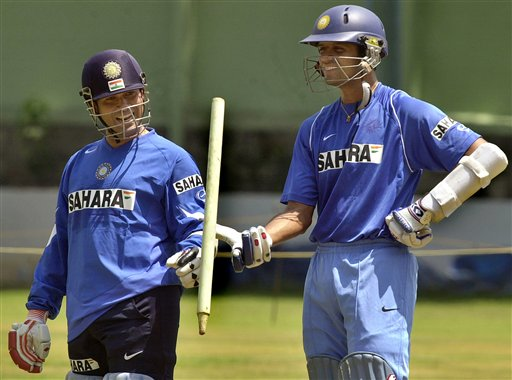 Indian captain Rahul Dravid, right, spins a wooden wicket as teammate Sachin Tendulkar looks on as the Indian cricket team prepares for the tri-nation series in Malaysia.