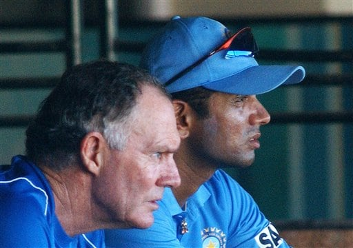 Indian Coach Greg Chappell, left, and Captain Rahul Dravid watch a practice match as the Indian cricket team prepares for the tri-nation series in Malaysia.