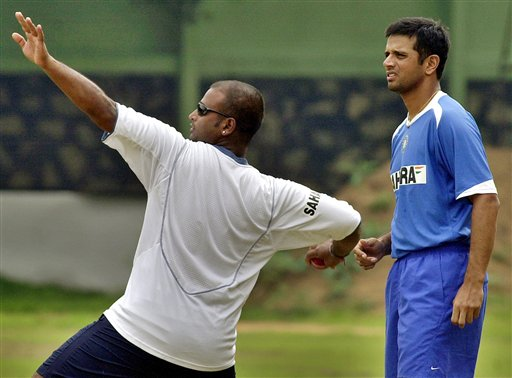 Rahul Dravid, right, looks on as teammate Ramesh Powar throws a ball during a training camp as the Indian team prepares for the tri-nation series in Malaysia.