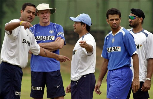 Dinesh Mongia, left, speaks to teammate Sachin Tendulkar, centre, as team coach Greg Chappell, second left, Captain Rahul Dravid, second right, and cricketer Harbhajan Singh look on, as the Indian team prepares for the tri-nation series in Malaysia.