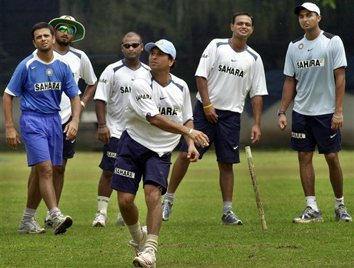 Sachin Tendulkar, front, throws a ball as teammates, from left to right, Captain Rahul Dravid, Harbhajan Singh, Ramesh Powar, Dinesh Mongia, and VRV Singh, watch as the Indian team prepares for the tri-nation series in Malaysia.