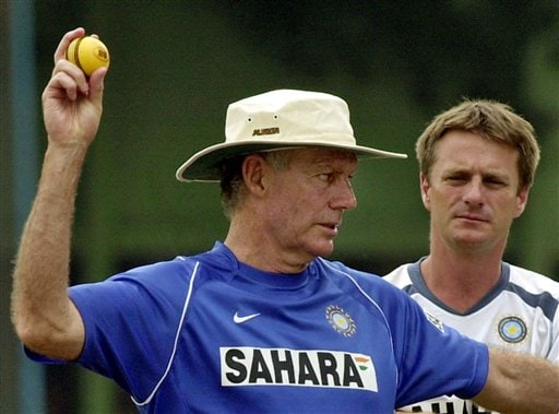 Indian Coach Greg Chappell, left, prepares to throw a ball as team physiotherapist John Gloster looks on during the training camp as the Indian team prepares for the tri-nation series in Malaysia.