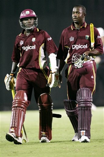 West Indies' batsmen Fidel Edwards, left, and Jerome Taylor walk off following their match against Australia in Kuala Lumpur.