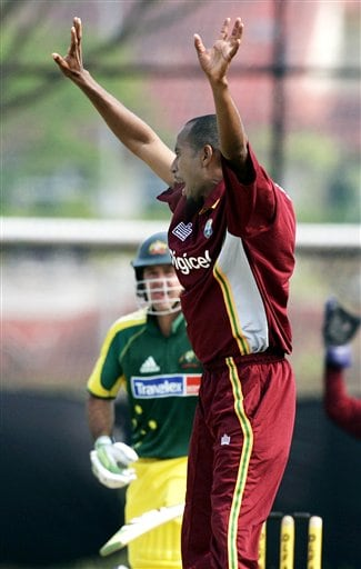 West Indies' bowler Ian Bradshaw, right, celebrates the wicket of Australian captain Ricky Ponting, left, trapped lbw for 56 runs in their match in Kuala Lumpur on Tuesday.