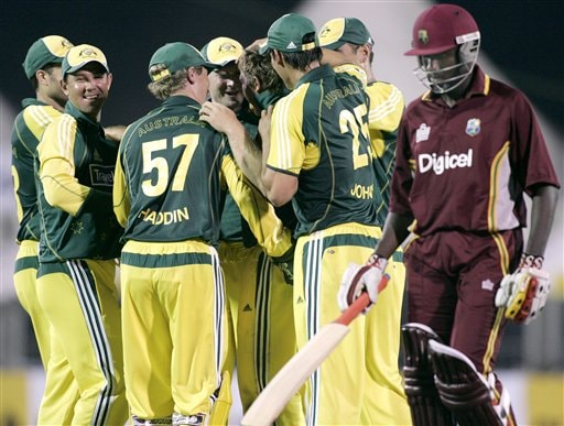 Australian teammates celebrate the first one-day wicket by Chris Cosgrove, forth right, dismissing the West Indies' batsman Wavell Hinds, right, for two runs in their match in Kuala Lumpur on Tuesday.