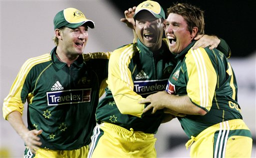 Australian teammates Michael Clarke, left, and Ricky Ponting, center, celebrate the first one-day wicket by Chris Cosgrove, right, against the West Indies in their match in Kuala Lumpur on Tuesday
