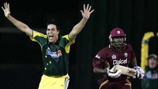 Australian bowler Mitchell Johnson, left, celebrates taking the wicket of West Indies' captain Brian Lara lbw for one run in their match in Kuala Lumpur on Tuesday.