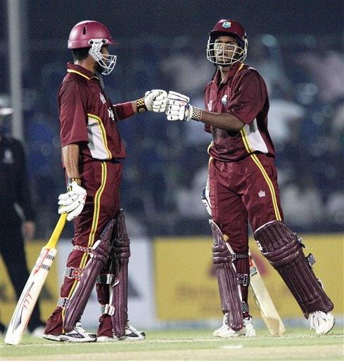 West Indies' batsman Shivnarine Chanderpaul, right, greets his teammate Ramnaresh Sarwan during their match against Australia in Kuala Lumpur on Tuesday.