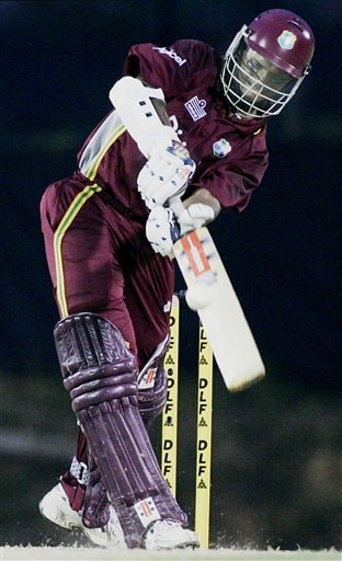 West Indies' batsman Shivnarine Chanderpaul hits for six against Australia in their match in Kuala Lumpur on Tuesday.