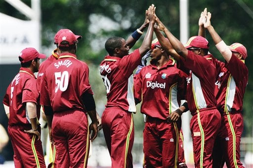 West Indies' bowler Fidel Edwards, center, celebrates with his teammates after dismissing Australian batsman Phil Jacques for two runs in their match in Kuala Lumpur on Tuesday.