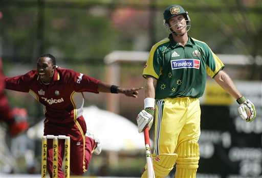 West Indies bowler Dwayne Bravo, left, starts to celebrate as Australian batsmen Matthew Hayden, right, is caught out for 49 runs in their tri-series match in Kuala Lumpur on Monday.