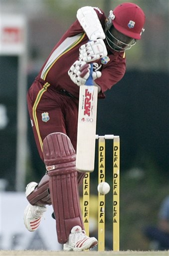 West Indies' batsman and captain Brian Lara drives a shot in their tri-series match against Australia in Kuala Lumpur on Monday.