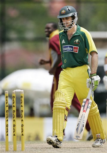 Australian batsman Simon Katich walks off after he was run out for 22 runs against the West Indies in their tri-series match in Kuala Lumpur on Monday.