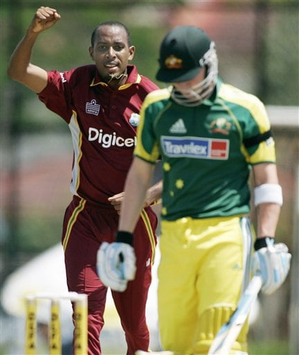 West Indies' bowler Ian Bradshaw, left, celertaes the wicket of Australian batsman Michael Clarke caught out for one run in their tri-series match in Kuala Lumpur on Monday.