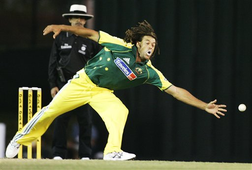 Australian bowler Andrew Symonds reaches for a catch against the West Indies in their tri-series match in Kuala Lumpur on Monday.