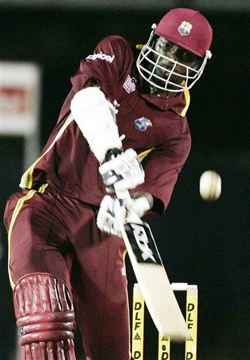 West Indies' batsman Chris Gayle drives the ball into the air for 6 runs off Australia's Stuart Clark in their tri-series match in Kuala Lumpur on Monday.