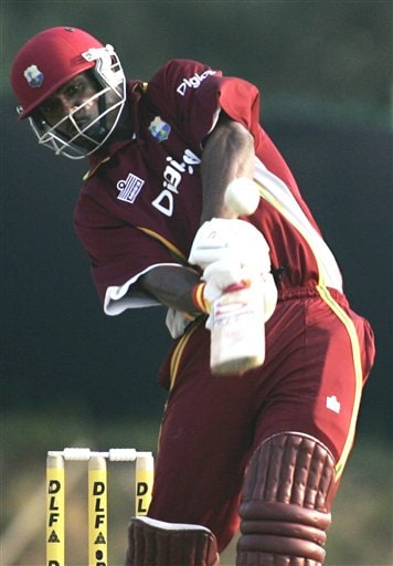 West Indies' batsman Runako Morton lifts a shot into the air off the bowling of India's Manuf Patel in their tri-series cricket match in Kuala Lumpur on Wednesday.