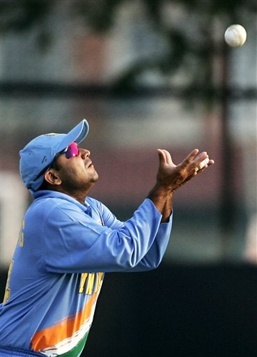 India's Verinder Sehwag prepares to catch out India's Shivnarine Chanderpaul for 21 runs their tri-series cricket match in Kuala Lumpur on Wednesday.