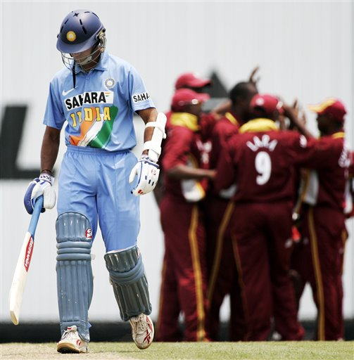 Indian captain Rahul Dravid, left, walks off after he was caught behind for no score as the West Indies celebrate in their tri-series match in Kuala Lumpur on Wednesday.