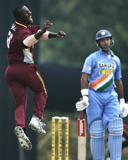 West Indies' Dwayne Smith, left, cheerfully appeals for a caught behind on India's batsman Yuvraj Singh for no score in their tri-series match in Kuala Lumpur on Wednesday.