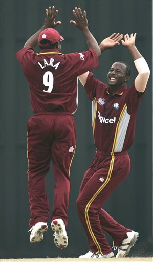 West Indies' captain Brian Lara, left, jumps up to celebrate with bowler Dwayne Smith after the dismissal of Indian batsman Yuvraj Singh for no score in their tri-series match in Kuala Lumpur on Wednesday.