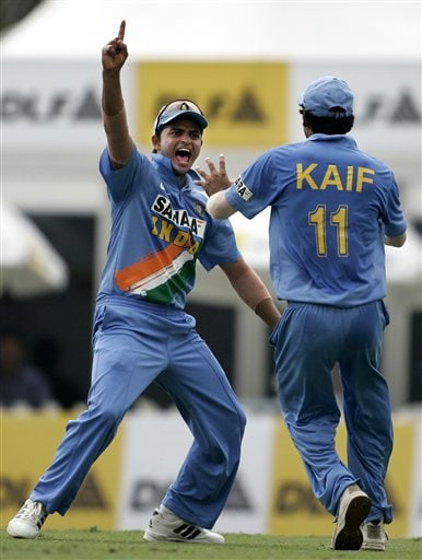 India's Suresh Raina, left, and Mohammad Kaif celebrate Raina's catch to take the wicket of Australian batsman Simon Katich for 9 runs in their tri-series in Kuala Lumpur on Friday.
