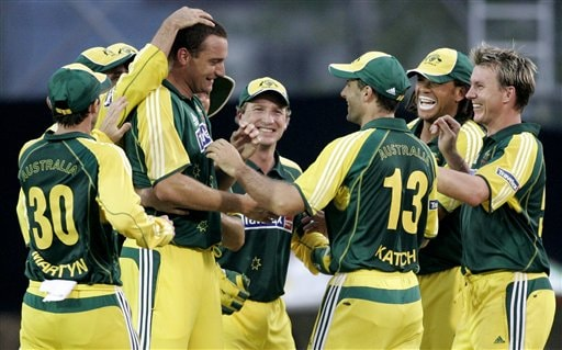 Australia's Stuart Clark, fourth left, celebrates with teammates after he caught and bowled India's Mohammad Kaif, left, for 21 in their tri-series cricket match in Kuala Lumpur on Friday.