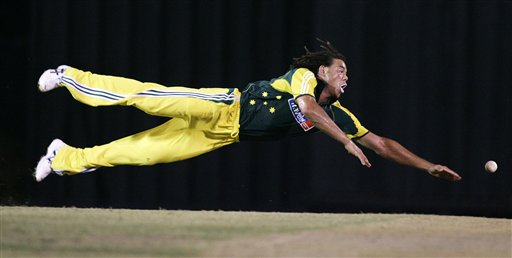 Australia's Andrew Symonds dives in a fielding attempt in their tri-series cricket match against India in Kuala Lumpur on Friday.