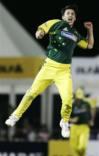 Australia's Brad Hogg jumps to celebrate taking the wicket of India's Ajit Akarkar for 9 runsas in their tri-series cricket match in Kuala Lumpur on Friday.