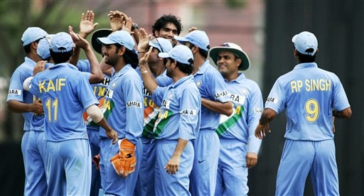 Indian teammates celebrate the wicket of Australian captain Ricky Ponting for 4 runs in their tri-series cricket match in Kuala Lumpur on Friday.