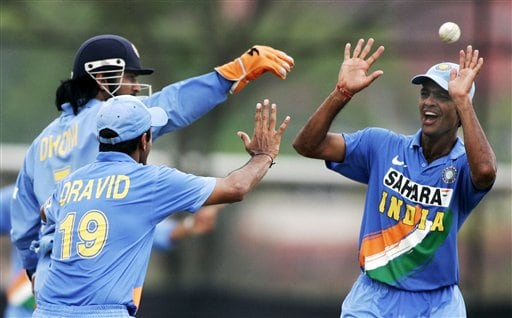Indian teammates Rudra Patrap Singh, right, Mahendra Singh Dhoni, and Rahul Dravid, left front, celebrate the wicket of Australia's Matthew Hayden for 54 runs in their tri-series cricket match in Kuala Lumpur on Friday.
