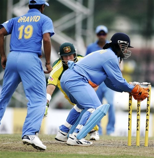 Australia's Matthew Hayden, center, is run out for 54 runsby India's wicketkeeper Mahendra Singh Dhoni, right, as Captain Rahul Dravid looks on in their tri-series cricket match in Kuala Lumpur on Friday.