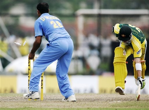 Australia's Damien Martyn, right is run out by Dinesh Mongia for 19 runs in their tri-series cricket match in Kuala Lumpur on Friday.