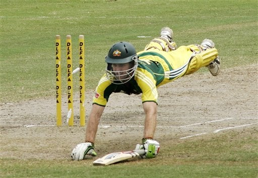 Australia's Simon Katich dives to avoid being run out during their final of the tri-nations series against the West Indies in Kuala Lumpur on Sunday.