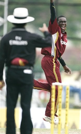 West Indies' Jerome Taylor, right, celebrates as he takes the wicket of Australian captain Ricky Ponting lbw for 6 runs during their final of the tri-nations series in Kuala Lumpur on Sunday.