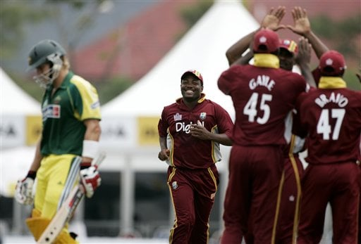 West Inides' cricket captain Brian Lara, center, runs in to celebrate with teammates after his Australian counterpart, Ricky Ponting, left, was dismissed lbw for 6 runs during their final of the tri-nations series in Kuala Lumpur on Sunday.