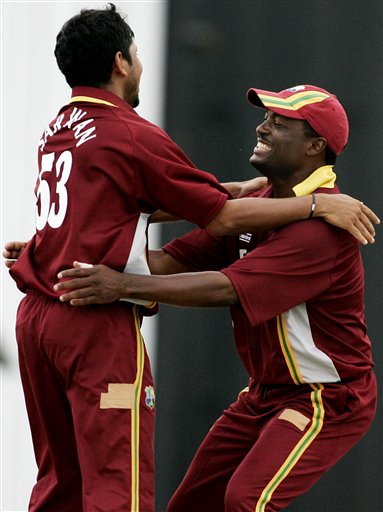 West Indies' captain Brian Lara, right, celebrates with teammate Ramnaresh Sarwan after they took the wicket of Australian batsman Andrew Symonds off Sarwan's bowling for 52 runs during their final of the tri-nations series in Kuala Lumpur on Sunday.