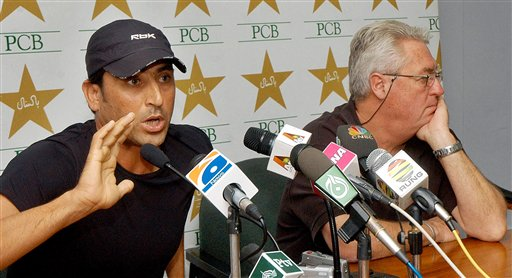 In this picture released by Pakistan Cricket Board, Pakistani cricketer Younis Khan, left, addresses a news conference with coach Bob Wolmer in Lahore on October 5, 2006. Khan refused to lead Pakistan in the Champions Trophy, two days ahead of the squad's departure to India for the limited-overs cricket tournament.