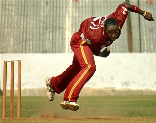 West Indies cricketer Fidel Edwards bowls during a practice match against GCA President XI ahead of the ICC Champions Trophy in Ahmedabad.
