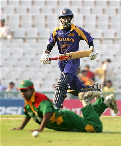 Sri Lanka's Upul Tharanga completes his 50th run, as Bangladesh's Aftab Ahmed looks on during the ICC Champions Trophy ODI match in Mohali on Saturday.