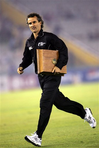 Cricket umpire Billy Bowden carries a case of cricket balls during the ICC Champions Trophy one-day international cricket match between Sri Lanka and Bangladesh in Mohali on Saturday.