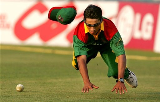 Bangladesh's Mohammad Ashraful dives to stop the ball from scoring a boundary against Sri Lanka during the first ODI of the ICC Champions Trophy in Mohali on Saturday.