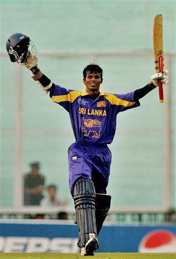 Sri Lanka's Upul Tharanga celebrates his century against Bangladesh during the ICC Champions Trophy ODI match in Mohali on Saturday.