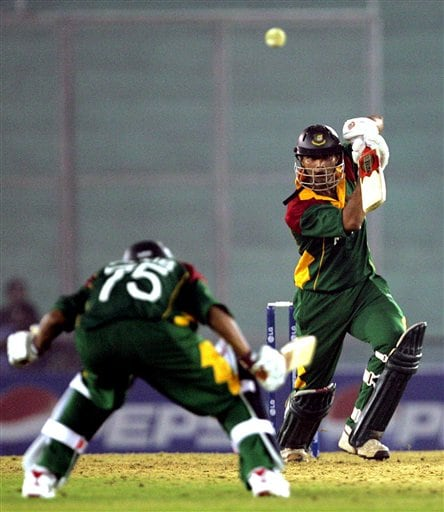 Bangladesh's Mushrafe Mortaza, right, bats, as teammate Saqibul Hasan avoids a hit while playing against Sri Lanka during the ICC Champions Trophy ODI match in Mohali on Saturday.