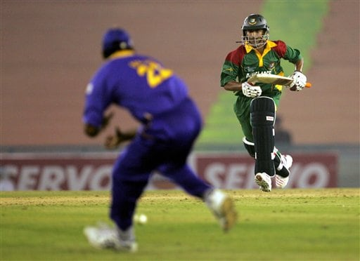 Bangladesh's Mushrafe Mortaza, right, completes a run as Sri Lanka's Chaminda Vaas collects the ball during the ICC champions trophy ODI match in Mohali on Saturday.