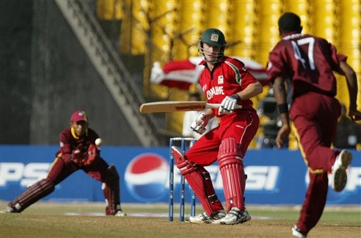 Zimbabwe's Anthony Ireland looks to West Indies bowler Cristopher Gayle, right, at ICC Champions Trophy 2nd qualifying match in Ahmedabad on Sunday.