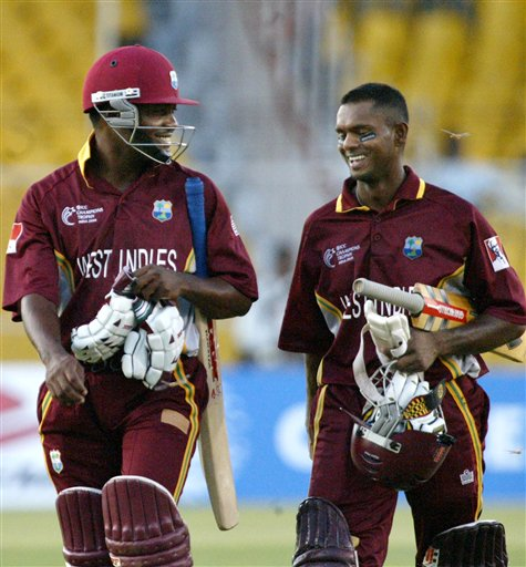 West Indies captain Brian Lara, left and team mate Shivnarine Chandepaul smile as they walk down the ground after defeating Zimbabwe by 9 wickets in the 2nd qualifying match of the Champions trophy in Ahmedabad on Sunday.
