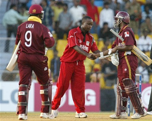 Shivnarine Chandepaul, right of West Indies shakes hand with Prosper Utseya, captain of Zimbabwe as captain Brian Lara, left walks after defeating Zimbabwe by 9 wickets in the 2nd qualifying match in Champions trophy at Ahmedabad on Sunday.