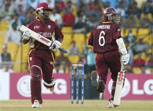 West Indies captain Brian Lara, left and Shivnarine Chandepaul, right looks to a ball as they run between the wickets during the 2nd qualifying match in Champions trophy in Ahmedabad on Sunday.