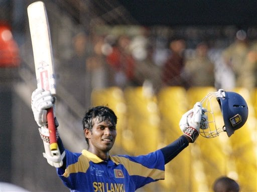 Sri Lankan cricketer Upul Tharanga acknowledges the crowd after scoring a century against Zimbabwe during the ICC Champions Trophy's qualifying match in Ahmedabad on Tuesday.